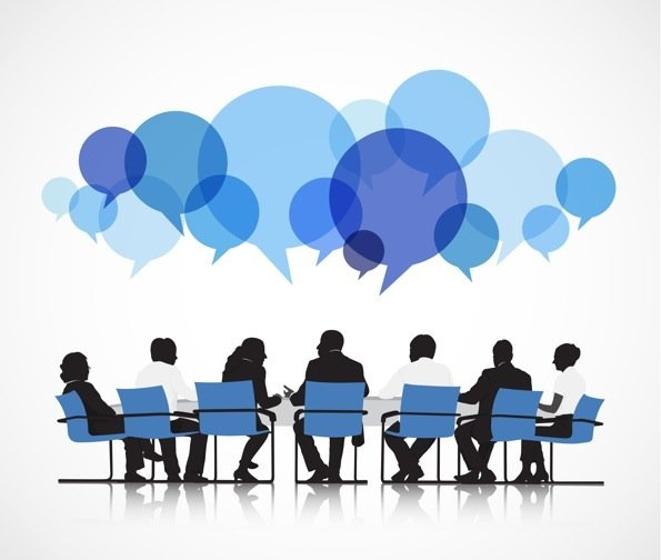 Graphic of a group of people sitting at a table, with various blue speak bubbles above their heads.